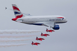 © under license to London News Pictures. 20/07/13 The Red Arrows fly in formation with the new British Airways Airbus A380 at the Royal International Air Tattoo at RAF Fairford<br />