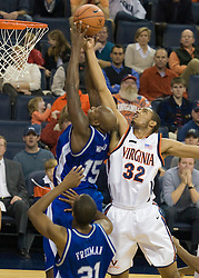 Virginia forward Mike Scott (32) shoots over Hampton Pirates forward Adrian Woodard (15).  The Virginia Cavaliers men's basketball team defeated the Hampton Pirates 79-65 at the John Paul Jones Arena in Charlottesville, VA on December 19, 2007.