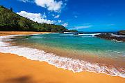 Sand and surf at Lumahai Beach, Island of Kauai, Hawaii USA