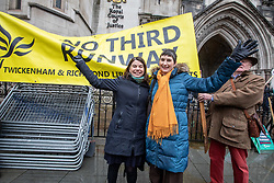 © Licensed to London News Pictures. 27/02/2020. London, UK. MP for Richmond Park, Sara Olney who beat Zac Goldsmith in the last general election, and Caroline Pidgeon Leader of the LibDems in the London Assembley celebrate at the Hight Court London as Heathrow's third runway is blocked by the Court of Appeal on environmental grounds. Photo credit: Alex Lentati/LNP