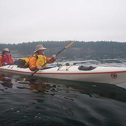 Nick and Brian Paddle Out of Reid Harbor, Stuart Island, Washington, US