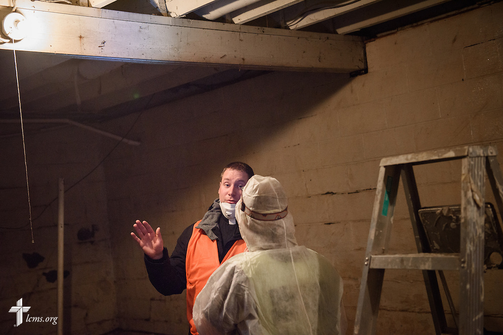 The Rev. Michael Meyer, manager of LCMS Disaster Response, talks to Laura Amidon of Mount Pulaski, Ill., as they clean a flood-damaged basement during a volunteer cleanup event on Saturday, Jan. 9, 2016, in Watseka. Ill. LCMS Communications/Erik M. Lunsford