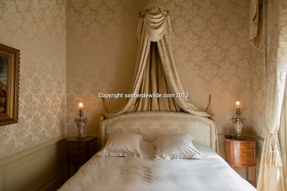 Bedroom with matching wallcovering and original lamps from the same century, designed by Interior architectThierry THENAERS for the Chateau d'Anthée, Belgium. 6th June 2013. Credit Sander de Wilde for The Wall Street Journal.  Castle