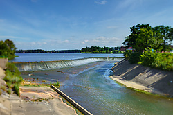 11 February 2015:    Lake Bloomington at the spillway.  The lake is at full level due to recent rainfall that has amounted to about twice he normal average.  The extra rain has come in showers hard enough to was lots of debris up and over the retaining wall leaving some teetering on the top.<br /> <br /> Selective focus achieved with T&S lens.<br /> <br /> This image was produced in part utilizing High Dynamic Range (HDR) processes.  It should not be used editorially without being listed as an illustration or with a disclaimer.  It may or may not be an accurate representation of the scene as originally photographed and the finished image is the creation of the photographer.