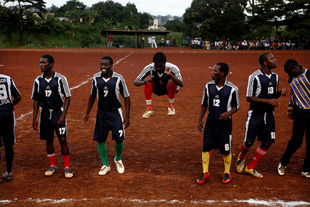 A tean warms up while they wait for the match officials insepection for a game at the Malitoli tournament at Cite Verte, saturday 24th of May 2008. Yaounde, Cameroon.