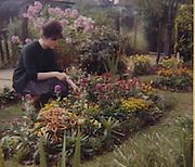 Irene Ottaway in her prefab garden, a UK100 in Queens Park, London, in the late 60s