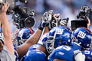 IRVING, TX - JANUARY 13:   New York Giants huddle together with TV cameras all around before a game against the Dallas Cowboys during the NFC Divisional playoff at Texas Stadium on January 13, 2008 in Dallas, Texas.  The Giants defeated the Cowboys 21-17.  (Photo by Wesley Hitt/Getty Images) *** Local Caption ***