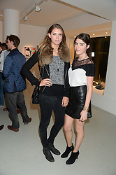 Left to right, SABRINA PERCY and LEXI ABRAMS at a private view of an exhibition of paintings by Billy Zane entitled 'Save The Day Bed' held at the Rook & Raven Gallery, Rathbone Place, London on 10th October 2013.