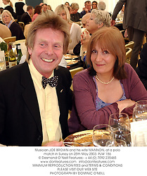Musician JOE BROWN and his wife MANNON, at a polo match in Surrey on 25th May 2003.PJW 186