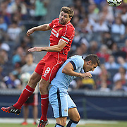 Steven Gerrard, Liverpool, wins a header over Stevan Jovetic, Manchester City, in action during the Manchester City Vs Liverpool FC Guinness International Champions Cup match at Yankee Stadium, The Bronx, New York, USA. 30th July 2014. Photo Tim Clayton