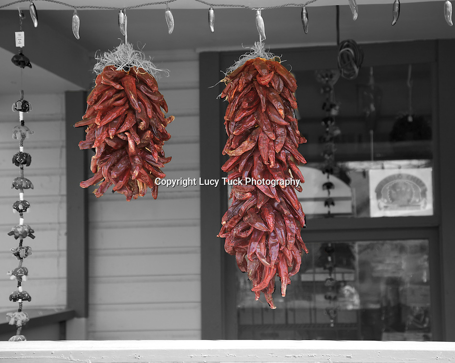 Bunches of chillis tied on porch