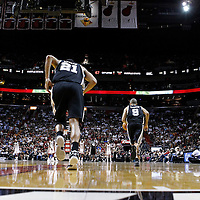 17 January 2012: San Antonio Spurs point guard Tony Parker (9) and San Antonio Spurs center Tim Duncan (21) are seen during the Miami Heat 120-98 victory over the San Antonio Spurs at the AmericanAirlines Arena, Miami, Florida, USA.