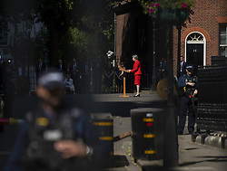 May 24, 2019 - London, England, United Kingdom - Police stand guard as Theresa May(M)the British Prime Minister is seen talking to the press outside 10 Downing street in London, United Kingdom. 24 May 2019. Theresa May today announced her resignation in wake of mismanaged Brexit Plan. (Credit Image: © Vernon Yuen/NurPhoto via ZUMA Press)