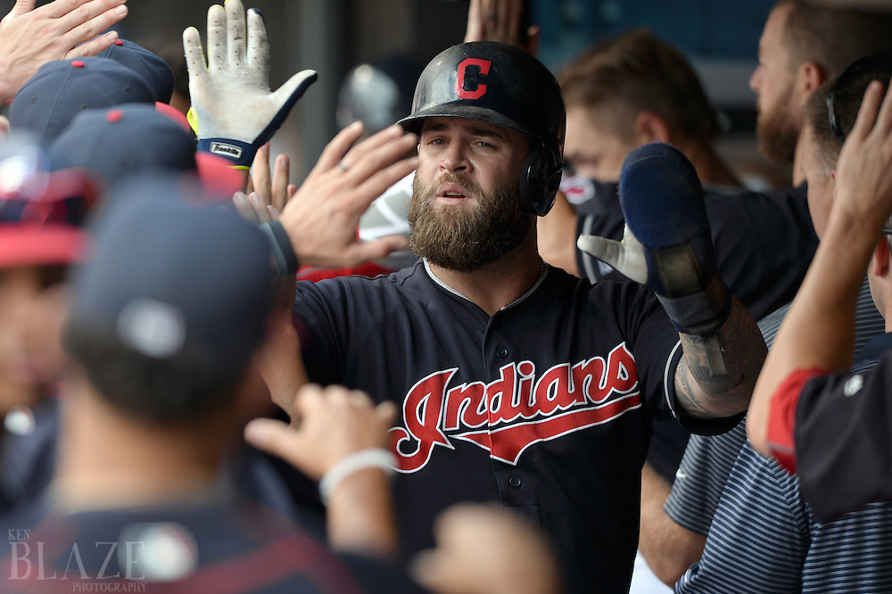 Jul 31, 2016; Cleveland, OH, USA; Cleveland Indians designated hitter Mike Napoli (26) celebrates after scoring during the fifth inning against the Oakland Athletics at Progressive Field. Mandatory Credit: Ken Blaze-USA TODAY Sports