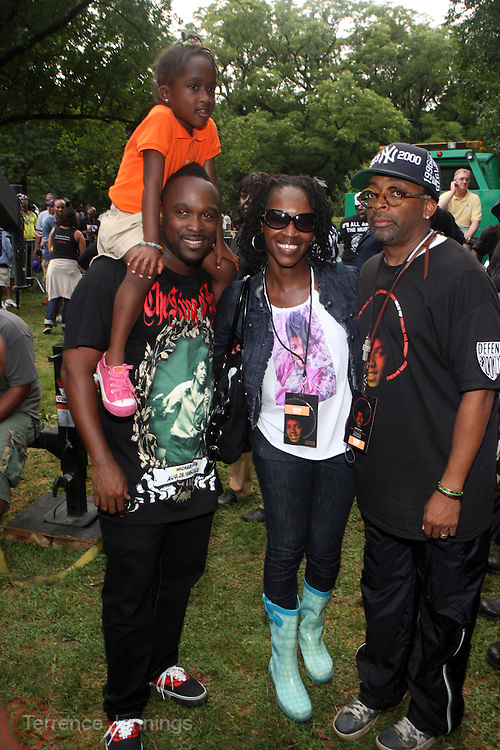 l to r: DJ Spinna w/daughter, Keita Peton, and Spike Lee at the Spike Lee's Brooklyn celebration for Michael Jackson's Birthday held at the Neader field in Prospect Park, Brooklyn on August 29, 2009..Filmmaker Spike Lee celebrates the ' King of Pop ' Birthday with a crowd packed party remembering the recently departing All time Great with a day long spinning of his music in Brooklyn's own Prospect Park