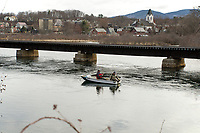 Anglers fish in the Winnipesaukee River during opening day for landlocked salmon/trout Wednesday morning.  (Karen Bobotas/for the Laconia Daily Sun)