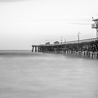 San Clemente pier black and white panoramic photo. San Clemente is a beach city along the Pacific Ocean in Southern California. Panoramic photo ratio is 1:3.  Copyright ⓒ 2017 Paul Velgos with All Rights Reserved.