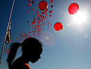 Virginia Tech sophomore Zebib Bahca pauses after she released balloons in the school colors at a ceremony for the victims killed on campus one week ago in Blacksburg, Virginia April 23, 2007.  REUTERS/Rick Wilking (UNITED STATES)
