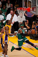 17 June 2010: Guard Rajon Rondo of the Boston Celtics passes the ball while being guarded by Ron Artest of the Los Angeles Lakers during the first half of the Lakers 83-79 championship victory over the Celtics in Game 7 of the NBA Finals at the STAPLES Center in Los Angeles, CA.