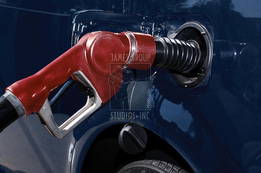 gasoline pump nozzle filling car's gas tank