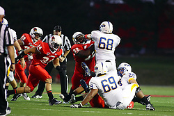 10 September 2011: Albert Sparks and Kalvin Harrington struggle as the play ends during an NCAA football game between the Morehead State Eagles and the Illinois State Redbirds at Hancock Stadium in Normal Illinois.