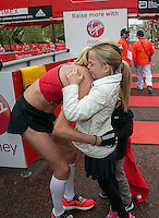 Paula Radcliffe with her daughter immediately after completing her last marathon in The Virgin Money London Marathon, Sunday 26th April 2015.<br /> <br /> Roger Allen for Virgin Money London Marathon<br /> <br /> For more information please contact Penny Dain at pennyd@london-marathon.co.uk