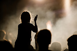 The silhouette of a young girl enjoying herself at the Brownstock Festival in Essex.