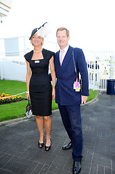 The EARL & COUNTESS OF DERBY at the Investec Ladies Day at Epsom Racecourse, Surrey on 4th June 2010.