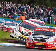 26:08:2012.BTCC weekend at Knockhill. .Gordon Shedden in Honda Civic  races to 3rd spot in the 1st race after nudging Aron Smith Ford Focus (car 5 on right of pic) aside on the final straight...Pic:Andy Barr.07974 923919  (mobile).andy_snap@mac.com.All pictures copyright Andrew Barr Photography. .Please contact before any syndication. .