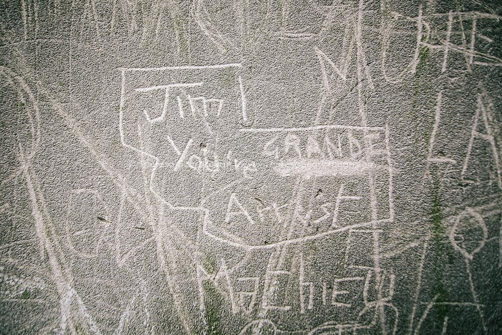 Graffiti tribute to Jim Morrison in Pere Lachaise Cemetery, Paris, France
