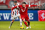Onderwerp/Subject: Eredivisie<br /> Reklame:  <br /> Club/Team/Country: <br /> Seizoen/Season: 2012/2013<br /> FOTO/PHOTO: Robbert SCHILDER (R) of FC Twente in duel with Robbie HAEMHOUTS (L) of Willem II. (Photo by PICS UNITED)<br /> <br /> Trefwoorden/Keywords: <br /> #04 $94 ±1355229149625 ±1355229149625<br /> Photo- & Copyrights © PICS UNITED <br /> P.O. Box 7164 - 5605 BE  EINDHOVEN (THE NETHERLANDS) <br /> Phone +31 (0)40 296 28 00 <br /> Fax +31 (0) 40 248 47 43 <br /> http://www.pics-united.com <br /> e-mail : sales@pics-united.com (If you would like to raise any issues regarding any aspects of products / service of PICS UNITED) or <br /> e-mail : sales@pics-united.com   <br /> <br /> ATTENTIE: <br /> Publicatie ook bij aanbieding door derden is slechts toegestaan na verkregen toestemming van Pics United. <br /> VOLLEDIGE NAAMSVERMELDING IS VERPLICHT! (© PICS UNITED/Naam Fotograaf, zie veld 4 van de bestandsinfo 'credits') <br /> ATTENTION:  <br /> © Pics United. Reproduction/publication of this photo by any parties is only permitted after authorisation is sought and obtained from  PICS UNITED- THE NETHERLANDS