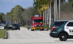 An ambulance leaves the rear entrance of Marjory Stoneman Douglas High School in Parkland, Thursday, February 15, 2018. Photo by Joe Cavaretta/Sun Sentinel/TNS/ABACAPRESS.COM
