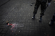 Next to the October Palace, a pool of blood remains on the spot where a protester was killed during previous clashes between anti-government protesters and riot police on Maidan Square, 21 February 2014.