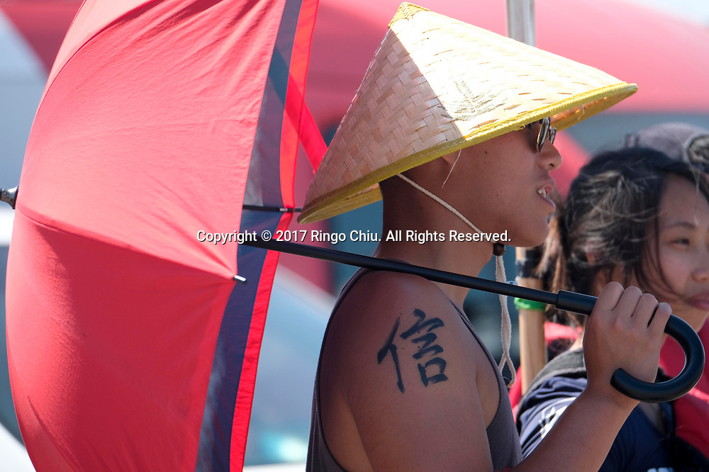 A man holds a umbella at Long Beach Dragon Boat Festival at Marine Stadium in Long Beach, California, on July 30, 2017. (Photo by Ringo Chiu)<br /> <br /> Usage Notes: This content is intended for editorial use only. For other uses, additional clearances may be required.
