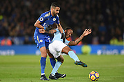 Leicester City midfielder Riyad Mahrez (26) tangles with Manchester City midfielder Raheem Sterling (7) during the Premier League match between Leicester City and Manchester City at the King Power Stadium, Leicester, England on 18 November 2017. Photo by Jon Hobley.