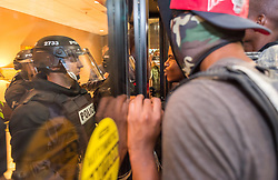 September 21, 2016 - Charlotte, North Carolina, U.S.- Protestors  confront police officers at the Omni Hotel during a protest and eventual riot in uptown. This is the second day of violence that erupted after a police officer's fatal shooting of an African-American man Tuesday afternoon. (Credit Image: © Sean Meyers via ZUMA Wire)