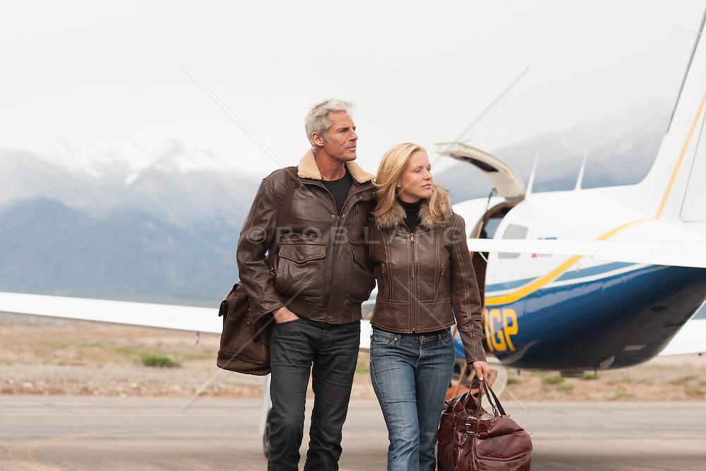 All American couple walking outdoors in beautiful coats