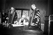 23/04/1964<br /> 04/23/1964<br /> 23 April 1964<br /> Honorary Degrees conferred at the National University of Ireland, Iveagh House, Dublin. <br /> Picture shows Right Rev. Monsignor Patrick J. I. McLaughlin (D.Sc. Degree), P.P. Carrigart, Co. Donegal, signing the register after the ceremony watched by President Eamon de Valera (right), Chancellor of N.U.I. and Dr. Seamus Wilmot, Registar of the University.