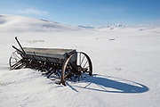Old grain drill and the Wallowa Mountains, Oregon.