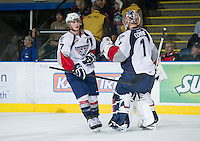 KELOWNA, CANADA - NOVEMBER 28: Connor Rankin #27 and Eric Comrie #1 of the Tri City Americans celebrate a goal against the Kelowna Rockets on November 28, 2012 at Prospera Place in Kelowna, British Columbia, Canada (Photo by Marissa Baecker/Shoot the Breeze) *** Local Caption ***