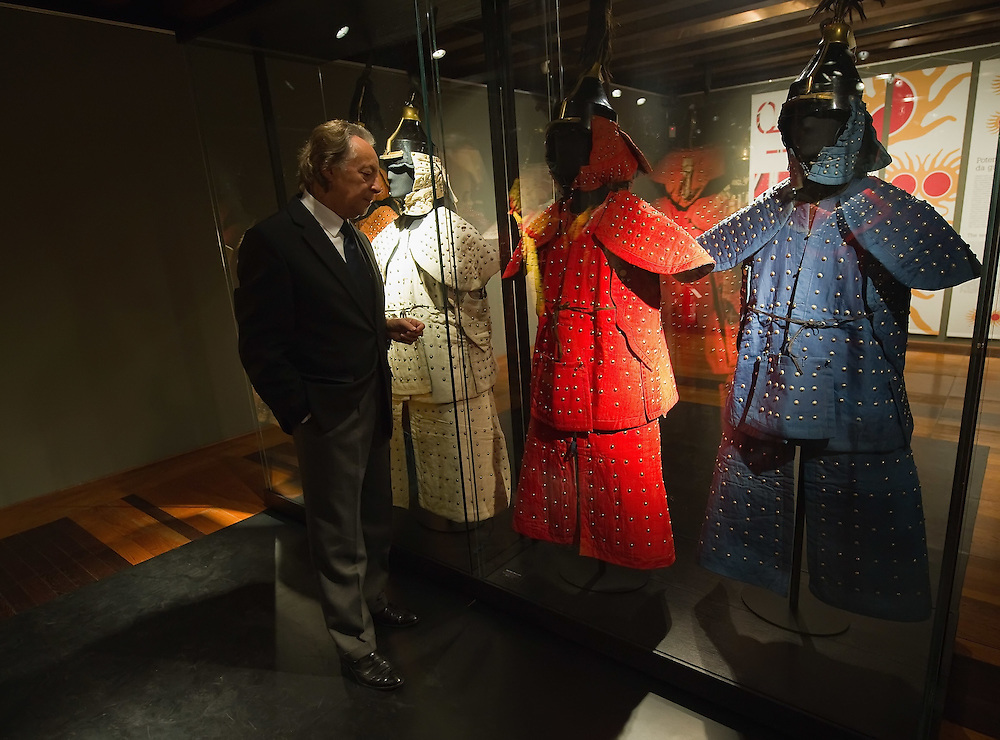 """TREVISO, ITALY - NOVEMBER 12:  Curator Adriano Madaro looks at some of the extremely rare military coats dating from 1644 belonging to the Manchu Army called """"Eight Banners"""" at the Case dei Carraresi on November 12, 2011 in Treviso, Italy.  The exhibition called, """"Manchu, The Last Emperor"""" will stay open until the 13th May 2012.  (Photo by Marco Secchi/Getty Images)"""