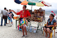 A woman is dressed in the tradicional costume with seven skirts, in the Sítio of Nazaré, Portugal. PHOTO PAULO CUNHA/4SEE