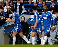 Photo: Ed Godden/Sportsbeat Images.<br />Chelsea v Wigan Athletic. The Barclays Premiership. 13/01/2007. Chelsea's Frank Lampard celebrates with his team mates after scoring to make it 1-0.