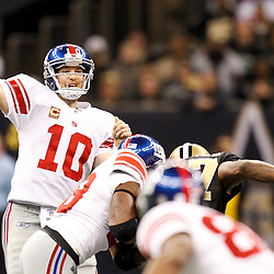 November 28, 2011; New Orleans, LA, USA; New York Giants quarterback Eli Manning (10) against the New Orleans Saints during the second quarter of a game at the Mercedes-Benz Superdome. Mandatory Credit: Derick E. Hingle-US PRESSWIRE