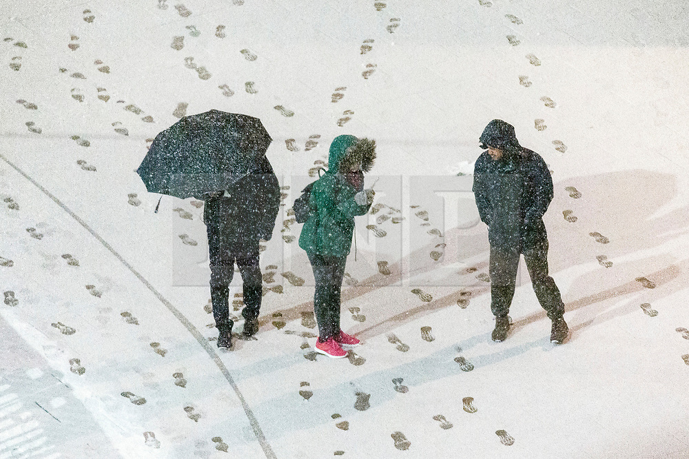 © Licensed to London News Pictures. 31/01/2019. London, UK. Commuters walking on the snow covered streets of Wembley. Photo credit: Ray Tang/LNP