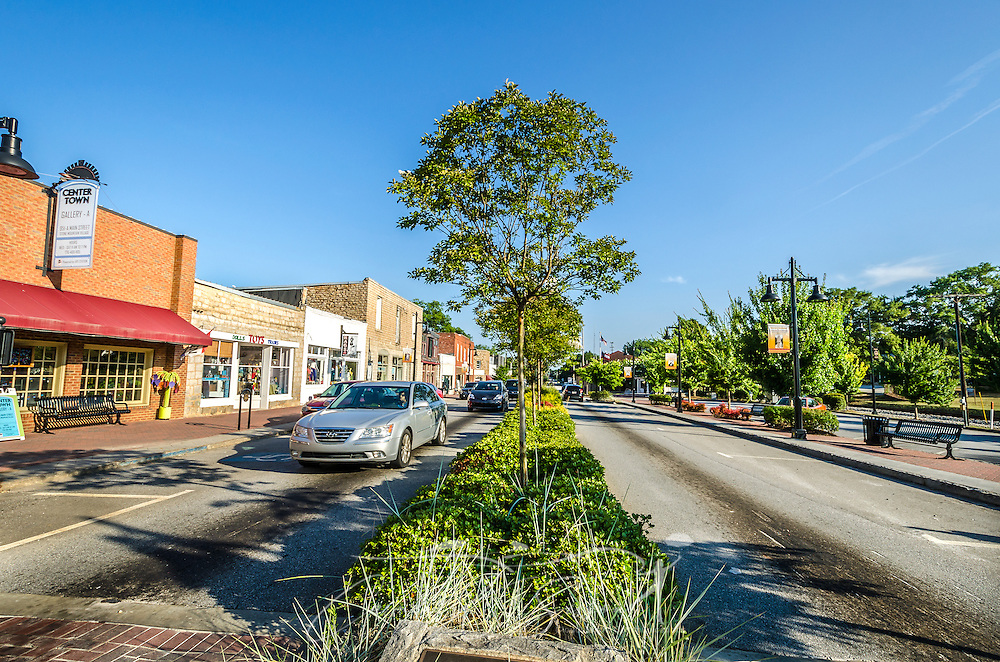 Cars pass down Stone Mountain Village's Main Street in Stone Mountain, Georgia, July 5, 2014. The village was established in 1839, and some of the buildings are more than 200 years old. Photo by Carmen K. Sisson/Cloudybright)