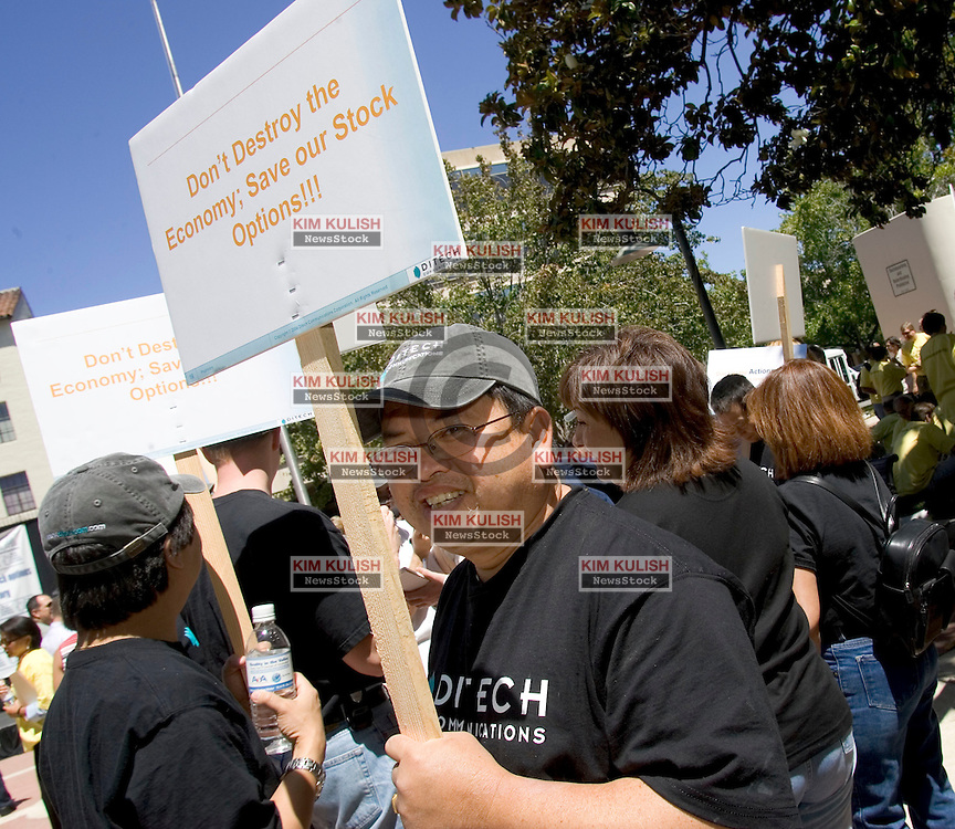 Palo Alto, CALIF. June 24, 2004--Tech workers rally during a protest at the Palo Alto Civic Center Plaza in Palo Alto, Calif., Thursday, June 24, 2004, led by the International Employee Stock Options Coalition which is attempting to help stop the expensing of stock options. Photo by Kim Kulish