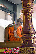 The Coolest Mummified Monk in the World<br /><br />The body of thailand's most famous mummified monk, Loung Pordaeng, is on display in a specially constructed building on Koh Samui island. When he died more than 20 years ago, as he was sitting in a meditation position. He is still in that same position and his body shows few signs of any major decay.<br />Phra Khru Samathakittikhun or Loung Por Daeng was born in 1894, and was a well respected family man within the local community on Koh Samui and first become ordained as a monk when he was in his early twenties. He spent two years in Wat Samret before exiting and marrying a local lady from Lamai with whom he had six children, a few still alive on the island today.<br />Upon reaching fifty years of age, once his children were all grown up, Loung Por Daeng, decided to dedicate the latter part of his life to Buddhism and returned to the temples where he felt so at peace. He was ordained as a monk in 1944.<br />After living in Bangkok and studying buddhism, he decided to return to his family home, which was located just behind the current Wat Kunaram. Most famously, two months before his death, at the age of 79 years and 8 months, he requested the company of his students to inform them that he felt his death was imminent and wanted to instruct them as to his last wishes. He requested that should his body decompose that he be cremated and his ashes scattered at the famous 'Saam Jaeg' in Hua Thanon, meaning the three forked road intersection, in Thai.<br />He went on to request that should his body not decompose, he would like to stay at the temple and be placed in an upright coffin on display as a symbol to inspire future generations to follow Buddhist teachings and be saved from suffering.<br />In his final seven days of mortal life, he no longer spoke to anyone or ate or drank anything, concentrating solely on his mediation and the path to enlightenment. He died a week later in the same position that we can see him sit