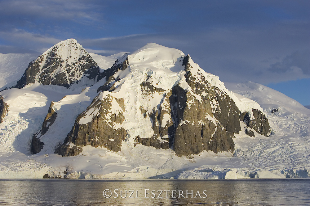 Mountains and glacier at sunset<br /> Cuverville Island, Antarctica