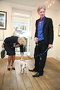 THE DUCHESS OF CORNWALL AND PHILIP TREACY  WITH ARCHIE.  Norman Parkinson and Philip Treacy, an exhibition of photographs by Norman Parkinson and drawings by celebrated milliner Philip Treacy. ELEVEN Gallery. VICTORIA. LONDON. 3 July 2007.  -DO NOT ARCHIVE-© Copyright Photograph by Dafydd Jones. 248 Clapham Rd. London SW9 0PZ. Tel 0207 820 0771. www.dafjones.com.
